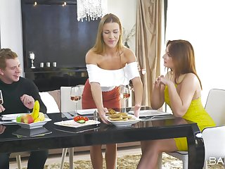 Elegant threesome during a behind the scenes dinner